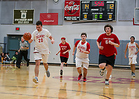 Keegan Donovan charges down court during the Belmont / Laconia Unified Basketball game Monday afternoon at Belmont High School.  (l-r) Keegan Donovan-20, Victoria Abate-27 Kyle Eldridge-35, Austin Hanscom-65 and Christian Marrone-11.   (Karen Bobotas/for the Laconia Daily Sun)