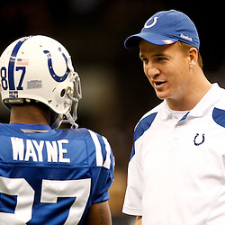 October 23, 2011; New Orleans, LA, USA; Indianapolis Colts quarterback Peyton Manning (18) talks with wide receiver Reggie Wayne (87) prior to kickoff of a game against the New Orleans Saints at the Mercedes-Benz Superdome. Mandatory Credit: Derick E. Hingle-US PRESSWIRE / © Derick E. Hingle 2011