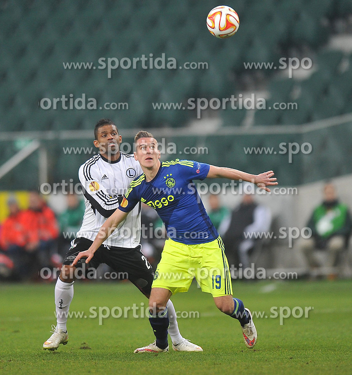 26.02.2015, Pepsi Arena, Warschau, POL, UEFA EL, Legia Warschau vs Ajax Amsterdam, 1. Runde, R&uuml;ckspiel, im Bild AJAX AMSTERDAMDOSSA JUNIOR ARKADIUSZ AREK MILIK // during the UEFA Europa League 1st Round, 2nd Leg match between Legia Warschau and Ajax Amsterdam at the Pepsi Arena in Warschau, Poland on 2015/02/26. EXPA Pictures &copy; 2015, PhotoCredit: EXPA/ Newspix/ NORBERT BARCZYK<br /> <br /> *****ATTENTION - for AUT, SLO, CRO, SRB, BIH, MAZ, TUR, SUI, SWE only*****