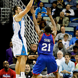 November 7, 2012; New Orleans, LA, USA; New Orleans Hornets power forward Ryan Anderson (33) shoots over Philadelphia 76ers small forward Thaddeus Young (21) during the second half of a game at the New Orleans Arena. The 76ers defeated the Hornets 77-62. Mandatory Credit: Derick E. Hingle-US PRESSWIRE