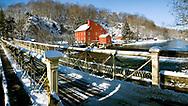 The historic Red Mill and bridge in Clniton NJ in winter