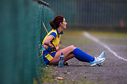 05/01/2019, Leinster Ladies Division 5 Hockey at St. Josephs Convent, Navan.<br /> Navan vs Tullamore<br /> Tullamore player - Eleanor Bagnall sits on the sideline nursing an injury <br /> David Mullen / www.cyberimages.net<br /> ISO: 1600; Shutter: 1/1250; Aperture: 4; <br /> File Size: 2.9MB