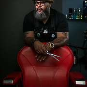 "Portraits of Reggie ""Hollywood the Barber"" Blagmon, in his studio space in Laurel, MD, on Monday, June 18, 2018. He's been a barber for 29 years, inspired by his father's style. His used to be a singer in the '70's for R&B groups, The Stridels and later, The Choice Four who had a few hits and once performed on Soul Train. John Boal Photography"