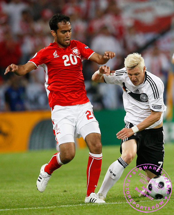 KLAGENFURT 08/06/2008.Euro 2008 - Group B.GERMANY v POLAND.ROGER GUERREIRO OF POLAND BATTLES WITH BASTIAN SCHWEINSTEIGER OF GERMANY ..*****************.FOT. PIOTR HAWALEJ / WROFOTO