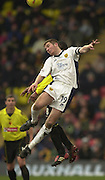 28/02/2004  -  Nationwide Div 1 Watford v Wimbledon.Wimbledon's Ben Chorley redirects the high ball after the challenge from Watfords Micah Hyde.