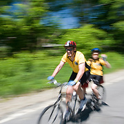 A man and his son streak down a road on a tandem bicycle. The 2007 Trek Across Maine, an annual project of the American Lung Association of Maine (ALAM).