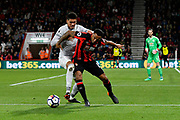 Callum Wilson (13) of AFC Bournemouth battles for possession with Chris Smalling (12) of Manchester United during the Premier League match between Bournemouth and Manchester United at the Vitality Stadium, Bournemouth, England on 18 April 2018. Picture by Graham Hunt.
