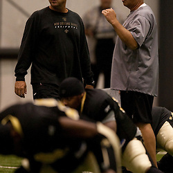 08 August 2009: Head coach Sean Payton (L) and defensive coordinator Gregg Williams (R) talk on the field before the start of the New Orleans Saints annual training camp Black and Gold scrimmage held at the team's indoor practice facility in Metairie, Louisiana.