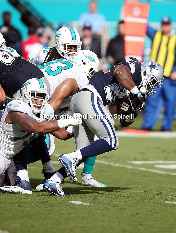 Dallas Cowboys running back Robert Turbin (23) runs the ball while trying to avoid a tackle attempt by Miami Dolphins defensive end Derrick Shelby (79) during the 2015 week 11 regular season NFL football game against the Miami Dolphins on Sunday, Nov. 22, 2015 in Miami. The Cowboys won the game 24-14. (©Paul Anthony Spinelli)