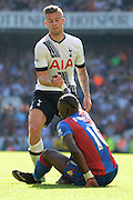 Toby Alderweireld helps up Yannick Bolasie during the Barclays Premier League match between Tottenham Hotspur and Crystal Palace at White Hart Lane, London, England on 20 September 2015. Photo by Alan Franklin.