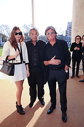 Left to right, DASHA ZHUKOVA, SIR DAVID TANG and RICHARD CARING at the BRIC art sale preview (Brazil, Russia, India & China, the acronym BRIC here refers to the burgeoning contemporary art practices within these four countries.) organised by Phillips de Pury & Company at The Saatchi Gallery, London on 17th April 2010.