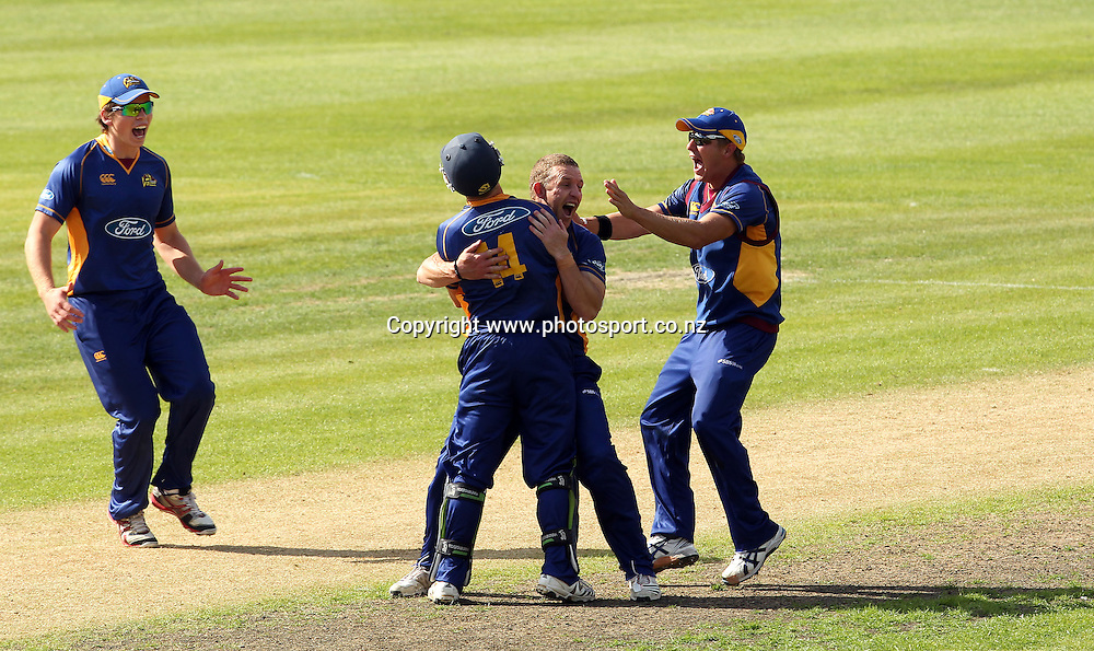 Craig Cumming celebrates taking the final Wizards wicket with his team-mates to give the Otago Volts an unlikely victory.<br /> Otago Volts v Canterbury Wizards, 5 February 2012, University Oval, Dunedin, New Zealand.<br /> Photo: Rob Jefferies/PHOTOSPORT