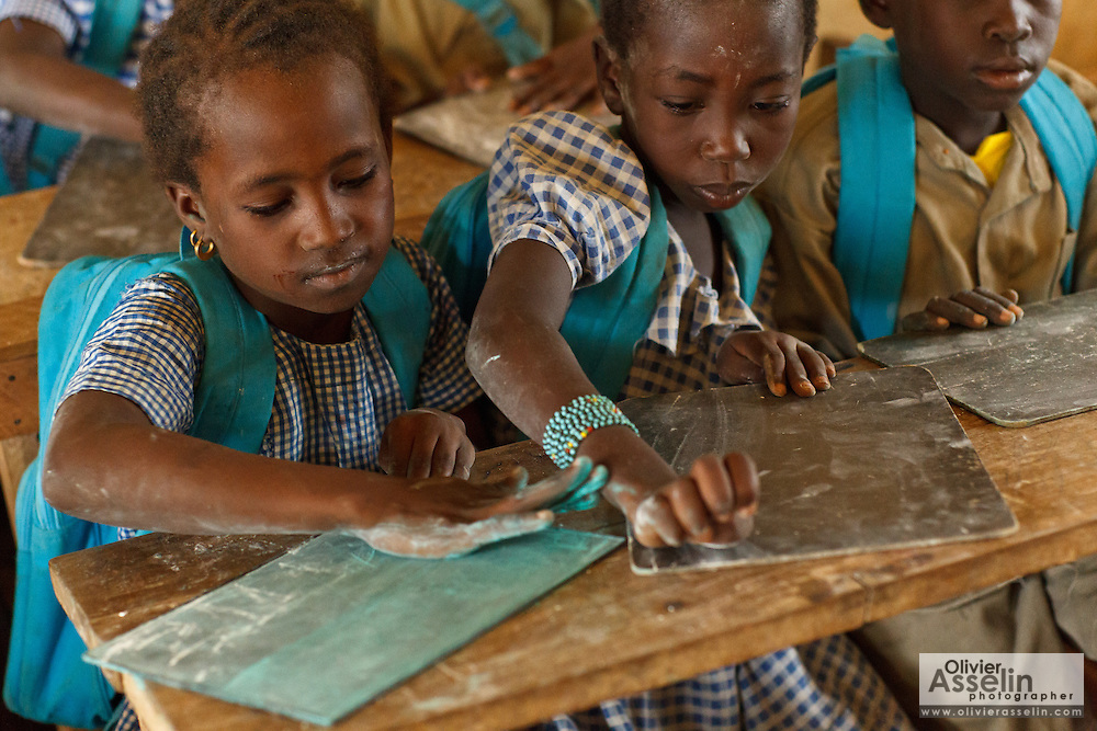 A girl erases her slate during class at the Faye primary school in the town of Faye, Bas-Sassandra region, Cote d'Ivoire on Monday March 5, 2012. The class has 79 students, and the school has been forced to refuse any additional students.