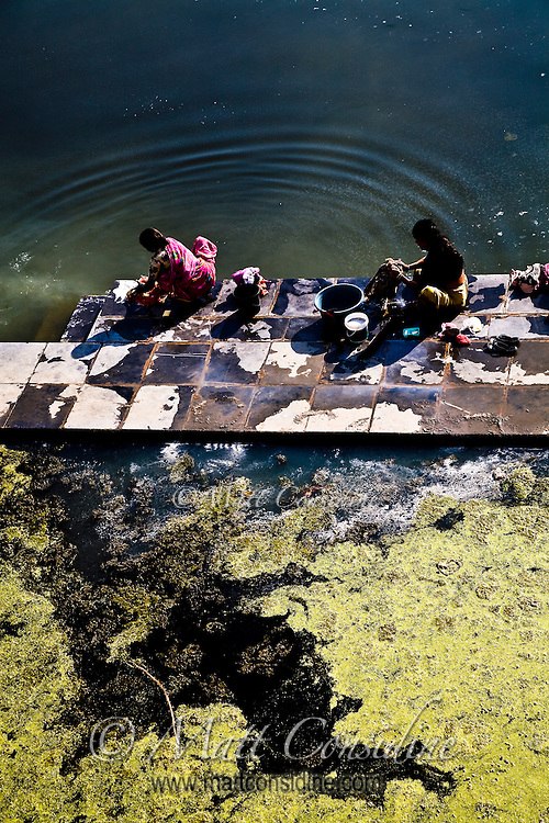 Women washing clothes on the banks of lake Pichola.<br /> (Photo by Matt Considine - Images of Asia Collection)