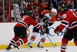 Oct 3, 2009; Newark, NJ, USA; New Jersey Devils defenseman Colin White (5) hits Philadelphia Flyers center Danny Briere (48) as he makes a pass during the first period at the Prudential Center.