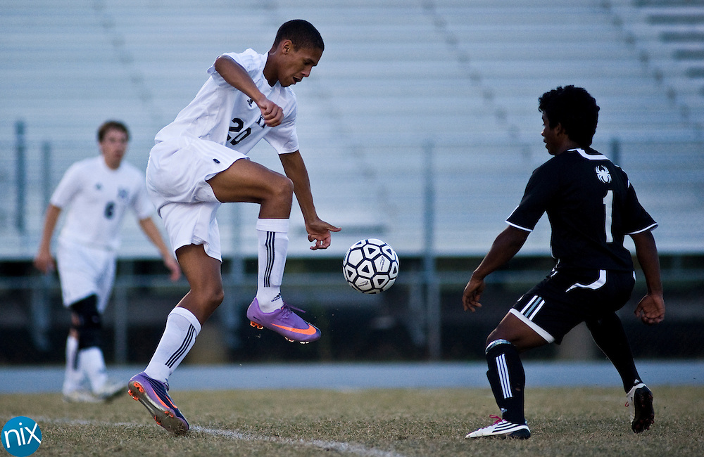 Hickory Ridge's Jerome Means tries to get past Concord's Christian Herrera during the South Piedmont Conference matchup Tuesday afternoon in Harrisburg. Concord won the game 4-1 to take first place in the conference.(Photo by James Nix)