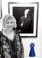 "Manhasset, New York, U.S., September 8, 2019. Ann Parry is honored her photo ""Buzz Aldrin"" won 1st Place in The Art Guild's ""About Face: The Portrait"" juried competition, at Elderfields, Manhasset, on Sept. 2019."