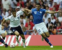Photo: Jonathan Butler.<br /> England v Israel. UEFA European Championships Qualifying. 08/09/2007.<br /> Joe Cole of England is held back by Valeed Badeer of Israel.