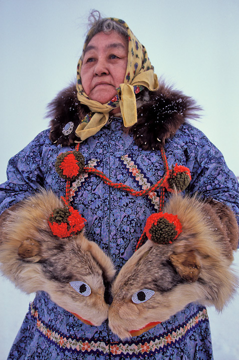 Iditarod observer, Emma Ivanoff, wears traditional parka and wolf gloves in the Iñupiaq village of Unalakleet, Alaska. These gloves are unique to Unalakleet where the wind blows and they provide needed warmth.