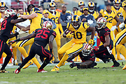 Los Angeles Rams wide receiver Pharoh Cooper (10) is chased by a group of defenders during the 2017 NFL week 3 regular season football game against the San Francisco 49ers, Thursday, Sept. 21, 2017 in Santa Clara, Calif. The Rams won the game 41-39. (©Paul Anthony Spinelli)