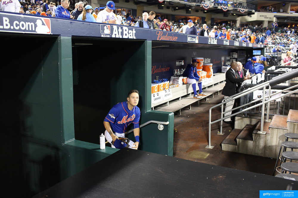 Wilmer Flores, New York Mets, in the dugout before the New York Mets Vs Los Angeles Dodgers, game three of the NL Division Series at Citi Field, Queens, New York. USA. 12th October 2015. Photo Tim Clayton for The Players Tribune