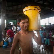Don Don works in the Hinigran fish market providing ice cooled storage for whole sale shoppers in the market. He also goes to Alternative Learning once a week provided by Quidan to secure him a degree. Quidan-Kaisahan is a charity working in Negros Occidental in the Philippines. Their aim is to keep children out of work to secure them education.