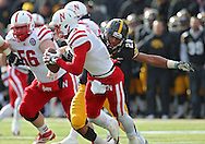 November 23 2012: Nebraska Cornhuskers quarterback Taylor Martinez (3) is sacked by Iowa Hawkeyes linebacker Christian Kirksey (20) during the first half of the NCAA football game between the Nebraska Cornhuskers and the Iowa Hawkeyes at Kinnick Stadium in Iowa City, Iowa on Friday November 23, 2012. Nebraska defeated Iowa 13-7 in the Heroes Game on Black Friday.