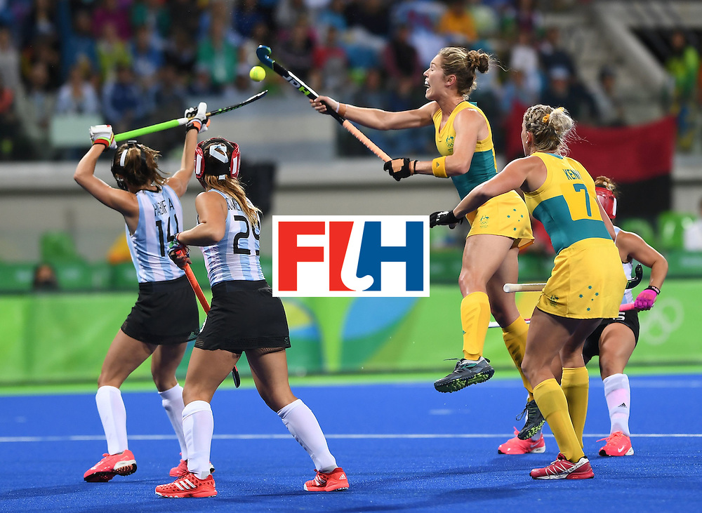 Australia's Georgina Morganm(C) jumps to hit the ball during the women's field hockey Australia vs Argentina match of the Rio 2016 Olympics Games at the Olympic Hockey Centre in Rio de Janeiro on August, 11 2016. / AFP / MANAN VATSYAYANA        (Photo credit should read MANAN VATSYAYANA/AFP/Getty Images)