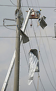 April 29,2014. Canton Mississippi. USA-<br /> <br /> Deadly Tornadoes Devastate Central and Southern US States<br /> <br /> Power line crews remove tornado debris from hight power lines after a tornado when through late Monday night of Pearl Mississippi Tuesday April 29,2014. No tornadoes were reported today as outbreak of severe storms will continue through Wednesday  with the death toll at 35 for the last three days.<br /> ©Exclusivepix