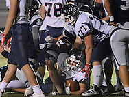 Central Bucks East's Jake Ventresca (24) looks out from the pile after scoring against Council Rock North in the first quarter at Council Rock North Saturday October 15, 2016 in Newtown, Pennsylvania.  (Photo by William Thomas Cain)