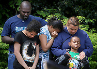 Willie, left, and Heidi Brown, right, bow their heads in prayer with their children Tasia, 13, Tanesha, 13, and Nate, 6, during Monday's Memorial Day service and World War I memorial dedication at War Memorial Park in Tacoma, May 30, 2011.(Janet Jensen/Staff photographer)