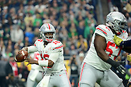 GLENDALE, AZ - JANUARY 01:  Quarterback J.T. Barrett #16 of the Ohio State Buckeyes throws a pass during the first quarter of the BattleFrog Fiesta Bowl against the Notre Dame Fighting Irish at University of Phoenix Stadium on January 1, 2016 in Glendale, Arizona.  (Photo by Jennifer Stewart/Getty Images)
