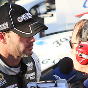 "Jimmie Johnson (48) interviews with the press after winning NASCAR SPRINT CUP ""AAA 400″ auto race at Dover International Speedway in Dover, DE Sunday,  Sept  29, 2013"