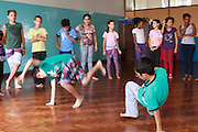 Children learning dance at Instituto Cristóvan School in São Paulo, Brazil. Missão Paz, an organisation that works in partnershp with C&A Foundation, pays for children to attend the school so that parents who are working in the textile industry can get on and work without worrying about looking after their childen at the same time.