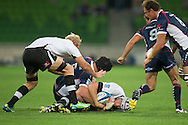 Rynier Bernardo (Kings) is tackled by Cadeyrn Neville (Rebels) during the Round 9 match of the 2013 Super Rugby Championship between RaboDirect Rebels vs Southern Kings at AAMI Park, Melbourne, Victoria, Australia. 13/04/0213. Photo By Lucas Wroe