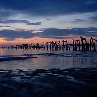 Laura Stoecker photo Tri Cities /// Sunrise reveals the remains of a pier in Bay St. Louis, Mississippi.