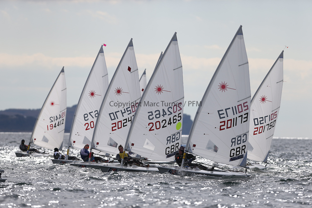 Day 2 of the RYA Youth National Championships 2013 held at Largs Sailing Club, Scotland from the 31st March - 5th April. ..202465, Edward JONES, Cvlsc, Laser Radial Leader in the pack...Image Credit Marc Turner / RYA.