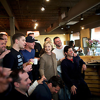 CHARLESTON, SC - FEBRUARY 26:  Democratic Presidential candidate, former Secretary of State Hillary Clinton gathers for a group photo with patrons while visiting Saffron's Cafe & Bakery February 26, 2016 in Charleston, South Carolina.  The South Carolina Democratic Presidential Primary is tomorrow.  Last Saturday, the South Carolina GOP Presidential Primary shattered records with 137,092 more votes cast than in any previous primary.  (Photo by Mark Makela/Getty Images)