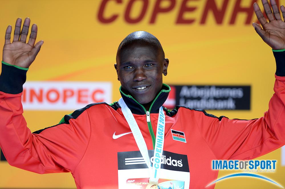 Mar 29, 2014; Copenhagen, Denmark; Geoffrey Kamworor (KEN) poses with medal after winning the mens race in 59:08 in the IAAF/AL-Bank World Half Marathon Championship. Photo by Jiro Mochizuki