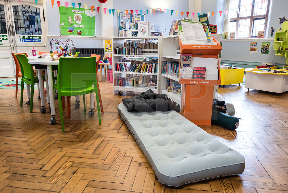 © Licensed to London News Pictures. 01/04/2016. London, UK. An air bed and sleeping bag on the floor of Herne Hill's Carnegie Library after local residents refused to leave in an effort to prevent its closure. Lambeth Council had planned to close the library last night (31st March) in order to turn it into a 'healthy living centre'. Photo credit : Rob Pinney/LNP