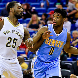 Mar 31, 2016; New Orleans, LA, USA; Denver Nuggets guard Emmanuel Mudiay (0) is defended by New Orleans Pelicans guard Jordan Hamilton (25) during the first quarter of a game at the Smoothie King Center. Mandatory Credit: Derick E. Hingle-USA TODAY Sports
