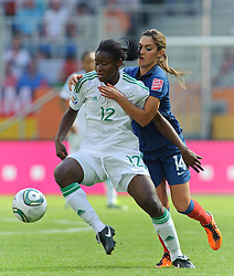 26.06.2011, Rhein-Neckar-Arena, Sinsheim, GER, FIFA Women's Worldcup 2011, GRUPPE A, NIGERIA (NGA) vs FRANKREICH (FRA) , im Bild Sarah MICHAEL (NGA #12,Orebro DFF SWE)  im Zweikampf mit Louisa NECIB (FRA #14, FCF Lyon)  // during the FIFA Women's Worldcup 2011, Pool A, Nigeria (NGA) vs France (FRA) on 2011/06/26, Rhein-Neckar-Arena, Sinsheim, Germany. EXPA Pictures © 2011, PhotoCredit: EXPA/ nph/  Roth       ****** out of GER / SWE / CRO  / BEL ******