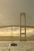 Newport, RI 2006 - newport bridge with dramatic light in clouds and one yacht on a mooring