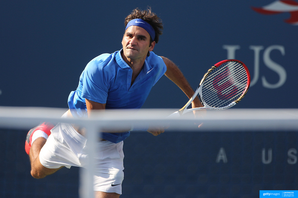 Roger Federer, Switzerland, in action against Grega Zemlja, Slovenia, during the Men's Singles competition at the US Open. Flushing. New York, USA. 27th August 2013. Photo Tim Clayton