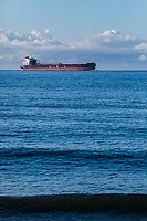 A large ship in the Strait of Juan De Fuca seen from Dungeness Recreation Area, Washington.