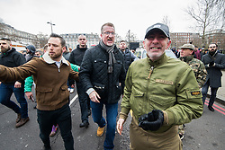 "© Licensed to London News Pictures . 18/03/2018 . London , UK . KEVIN CARROLL and supporters of Tommy Robinson and Martin Sellner celebrate the speech going ahead after Tommy Robinson leaves . 1000s including supports of alt-right groups such as Generation Identity and the Football Lads Alliance , at Speakers' Corner in Hyde Park where Tommy Robinson reads a speech by Generation Identity campaigner Martin Sellner . Along with Brittany Pettibone , Sellner was due to deliver the speech last week but the pair were arrested and detained by police when they arrived in the UK , forcing them to cancel an appearance at a UKIP "" Young Independence "" youth event , which in turn was reportedly cancelled amid security concerns . Photo credit: Joel Goodman/LNP"