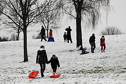 © Licensed to London News Pictures. 19/01/2013, London, UK.  People enjoy a snow covered slope in a park in Croydon, South London, Saturday, Jan. 19, 2013. More cold weather and snow are expected over the coming days. Photo credit : Sang Tan/LNP