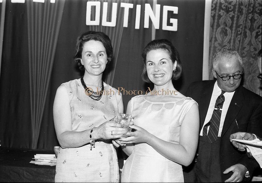 14/05/1965<br /> 05/14/1965<br /> 14 May 1965<br /> Esso Golf Outing at Woodbrook Golf Club, Bray, Co. Wicklow. Mrs J.H. Donovan, (left) wife of the Managing Director of Esso, presenting the Lady visitors prize to Mrs H. Robinson.