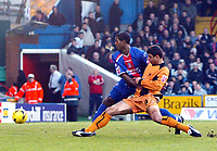 Photo: Chris Ratcliffe.<br />Crystal Palace v Wolverhampton Wanderers. Coca Cola Championship. 10/12/2005.<br />Ioan Ganea of Wolves fails to get a touch as Mikele Leigertwood (L) closes him down. The ball skids into the goal anyway from Ki-Hyeon Seol