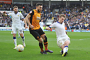 Hull City midfielder Robert Snodgrass (10) takes shot at goal deflected by Charlie Taylor (21) of Leeds United  during the Sky Bet Championship match between Hull City and Leeds United at the KC Stadium, Kingston upon Hull, England on 23 April 2016. Photo by Ian Lyall.